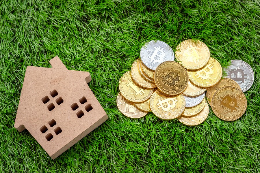 Недвижимость за криптовалюту: возможно ли купить жилье в России при помощи биткойнов